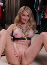 Busty mature amateur Eva Griffin spreads tasty pussy.