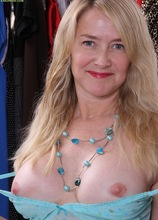 Busty mature amateur Eva Griffin naked in closet.