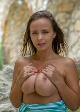 Big natural breasted MILF Stella Jones fingers her twat outdoors.