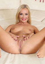 Blonde MILF Victoria Pure strips naked on her birthday.